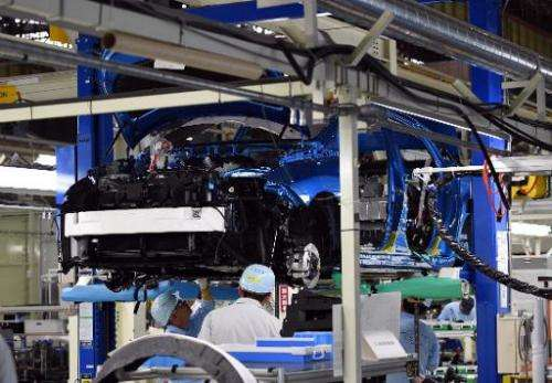 Employees of Toyota Motors assemble the Mirai sedan at the Motomachi factory in Toyota city, Aichi prefecture, on February 24, 2