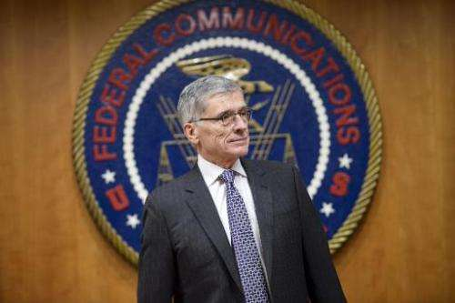 Federal Communication Commission Chairman Tom Wheeler waits for a hearing at the FCC in Washington, DC, on December 11, 2014