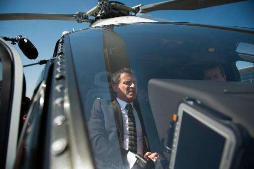French Prime Minister Manuel Valls sits in an H160 as he visits the Airbus helicopter factory in Marignane, southern France,on M