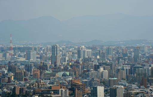 Fukuoka city on Japan's southern main island of Kyushu is seen blanketed in smog, in March 2013
