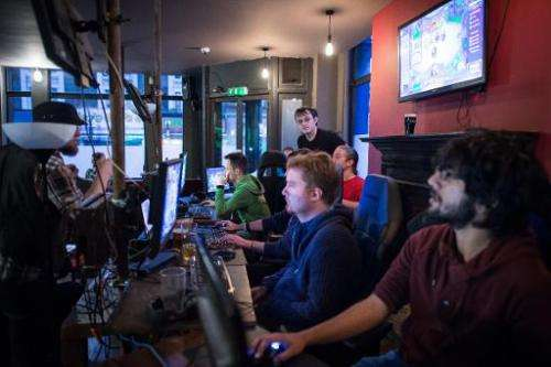 "Gamers take part in a tournament at an ""e-sports"" bar in north London on February 14, 2015"