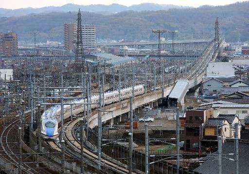 Hokuriku 'shinkansen', or bullet train, heads out of Kanazawa station in Ishikawa prefecture, on March 14, 2015
