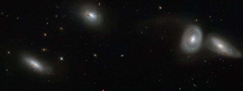 Hubble views a bizarre cosmic quartet