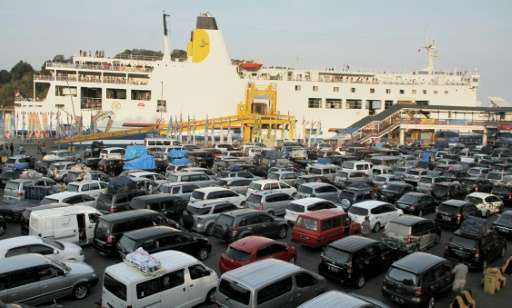 Hundreds of vehicles arrive at Merak port in western Java island on July 15, 2015 to make the ferry crossing to Sumatra island