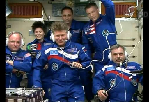 Image from NASA TV shows (front) Scott Kelly, Gennady Padalka  and Mikhail Kornienko and (back) Samantha Cristoforetti, Anton Sh