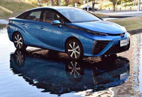 "Japanese auto giant Toyota Motor's fuel cell vehicle ""Mirai"" is displayed in Tokyo on November 18, 2014"