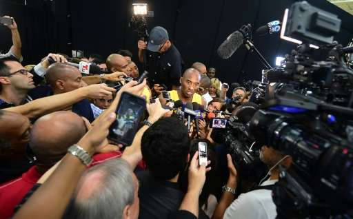 Kobe Bryant of the Los Angeles Lakers avoided a massive media scrum like the one he faced here on September 28, 2015, by announc