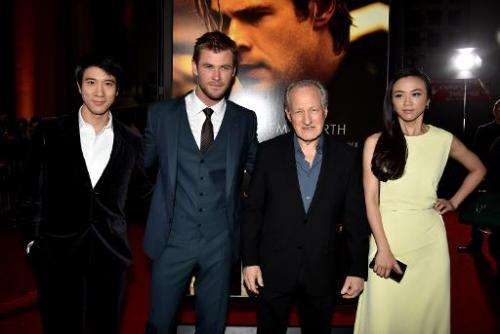"""(L-R) Actors Wang Leehom, Chris Hemsworth, director Michael Mann and actress Tang Wei at the premiere of """"Blackhat"""" at"""