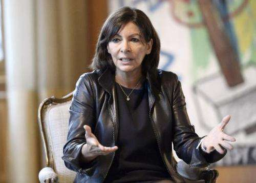 Mayor of Paris Anne Hidalgo, seen here at the city hall of Paris on November 17, 2014, will formally submit her anti-pollution p