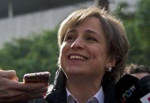 Mexican journalist Carmen Aristegui speaks to the press in Mexico City on March 16, 2015, a day after being fired