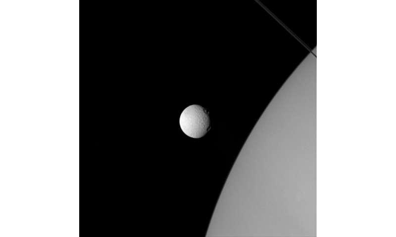 NASA image: Tethys 'eyes' Saturn