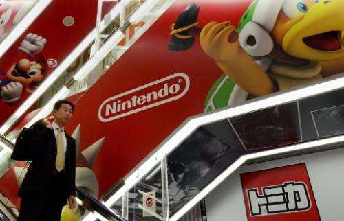 Nintendo shares have zoomed up more than 21 percent after the videogame giant said it will enter the booming market for games on