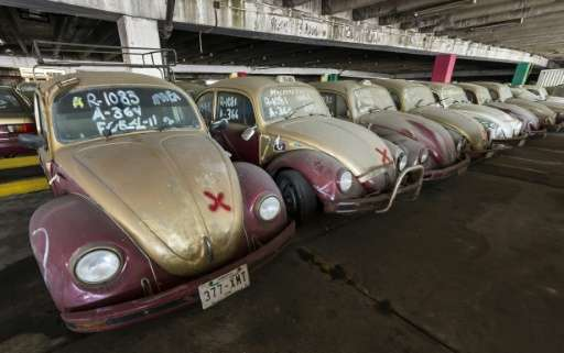 Old Volkswagen Beetles, once used as taxi cabs, in a yard for impounded cars in Mexico City on June 23, 2015