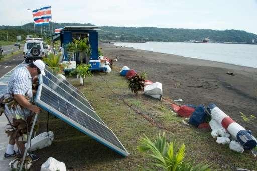 Owner Luis Diego Vasquez installs more solar panels for the Churchill Mamiche ice-cream  parlour