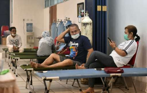 People are treated at a local hospital with fresh oxygen in Palangkaraya, the city worst-hit by toxic haze