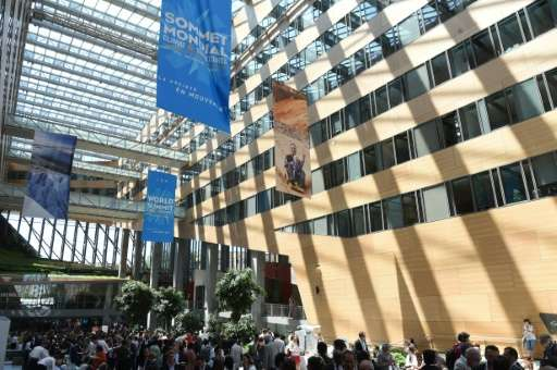 People arrive for the World Summit - Climate and Territories on July 1, 2015 in Lyon