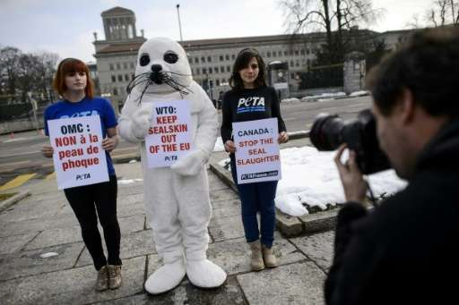 People for the Ethical Treatment of Animals (PETA) activists stage a demonstration against seal hunting in front of the World Tr