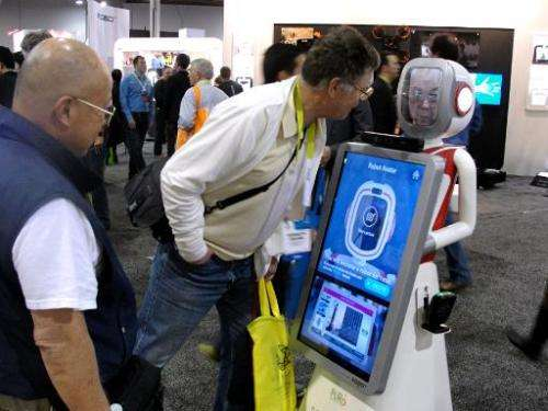 People look at a robot at the Consumer Electronics Show in Las Vegas January 6, 2015