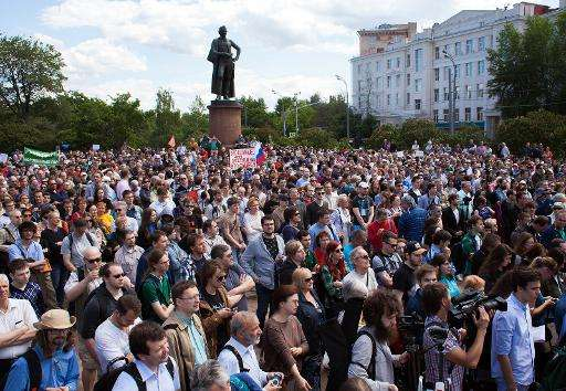 People take part in an anti-government demonstration called by Russian scientists in Moscow on June 6, 2015