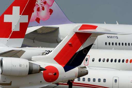 Planes stand on the tarmac before the opening of the Paris Air Show at Le Bourget, on June 13, 2015