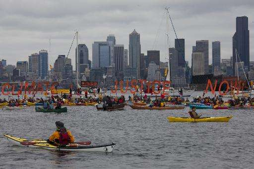 """Protesters shouted """"Shell, no!"""", banged their oars on the sides of their boats and paddled around to play cat-and-mous"""