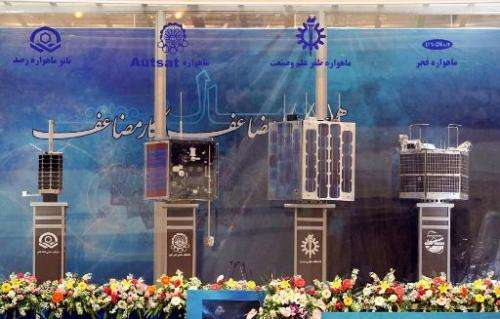 Prototypes for four Iranian home-built satellites (from L) Rasad, Amir Kabir-1, Zafar and Fajr on display during their unveiling