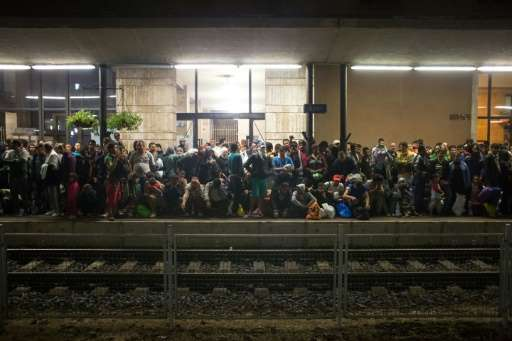 Refugees wait for a train from Gyor to Hegyeshalom in Hungary on September 19, 2015