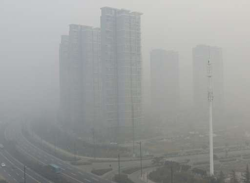 Residential blocks are seen covered in smog in Lianyungang, eastern China's Jiangsu province on November 30, 2015