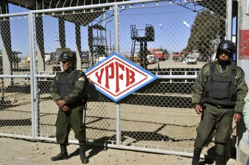 Riot police officers guard a plant of Bolivia's state-controlled oil company YPFB on July 12, 2011