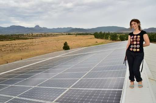 """Rosetta Fanari posing on the roof of her """"Nuova Sarda Industria Casearia"""" using a photovoltaic system to supply the en"""
