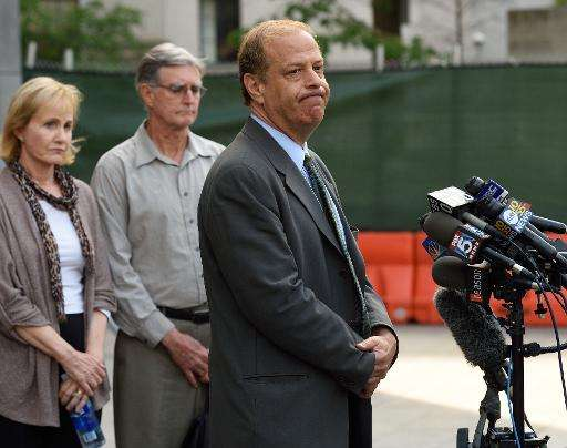 Ross Ulbricht's attorney Joshua Dratel (R) speaks to reporters as Lyn (L) and Kirk (C) Ulbricht, parents of Silk Road founder Ro