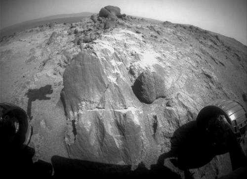 Rover examining odd Mars rocks at valley overlook