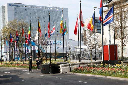 Security guards stand in a street on the opening day of the Global Conference of Cyberspace in The Hague on April 16, 2015