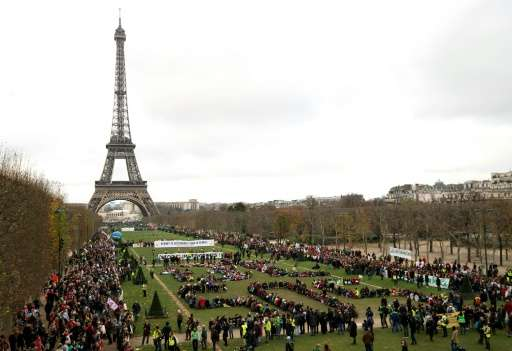 Several NGOs gather to form a human chain on the Champs de Mars near the Eiffel Tower on December 12, 2015