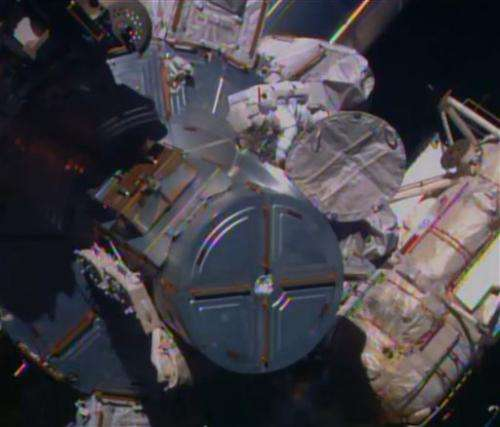 Spacewalking astronauts turn cable guys in 1st of 3 jobs
