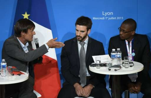 Special envoy of the French President for the protection of the planet Nicolas Hulot (L) talks with representatives during the &