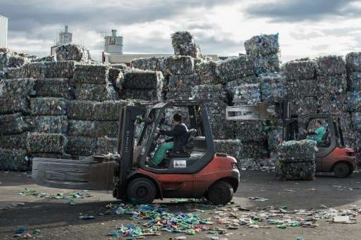Stacks of plastic waste collected at sea at a processing plant in Chiva, near Valencia in Spain