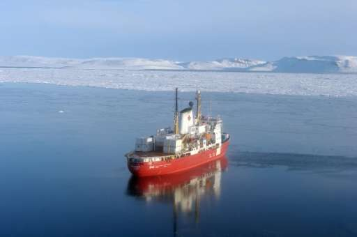 The CCGS Amundsen reasearch ice breaker navigates near Devon Island in the Canadian High Arctic on September 27, 2015