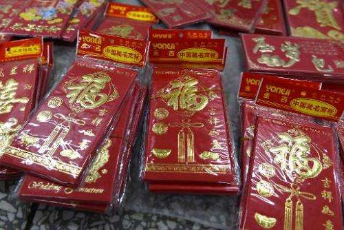 The Chinese tradition of giving gifts of money in red envelopes at Lunar New Year has turned into big business for Web giants Al