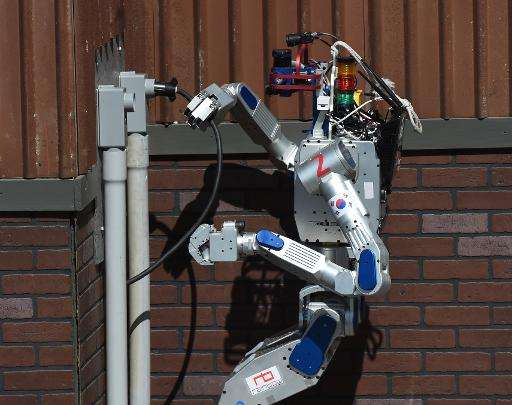 The humanoid robot 'DRC-Hubo' developed by Team KAIST from South Korea completes a task before winning the finals of the DARPA R