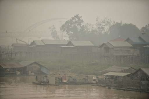 The Kahayan riverbank in Palangkaraya, a city of 240,000 that has been engulfed in poisonous darkness by smoke from peat land se