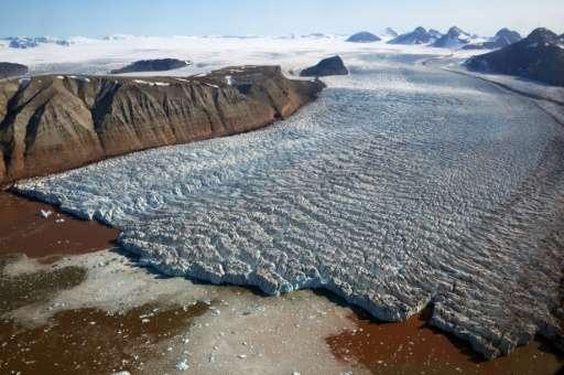 The Kronebreen glacier with red traces of sediments near the scientific base of Ny Alesund