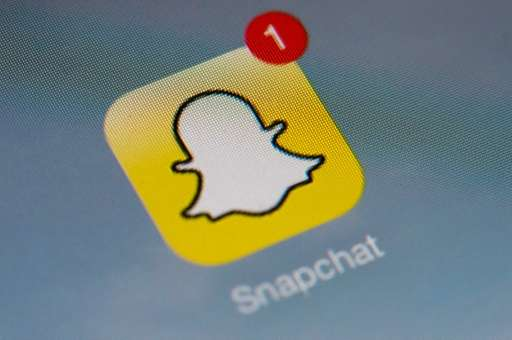 "The logo of mobile app ""Snapchat"" is displayed on a tablet on January 2, 2014 in Pari"