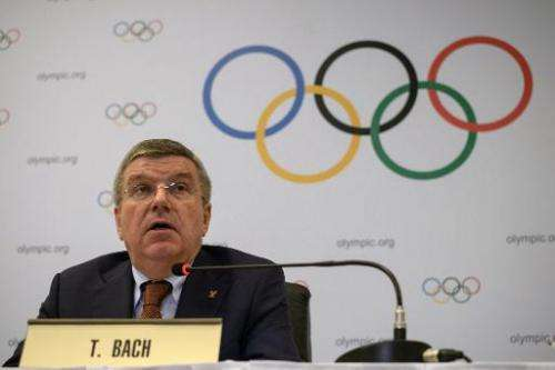 The president of the International Olympic Committee, Thomas Bach speaks to the media at the end of an IOC Executive Board meeti