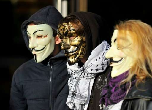 "The ""Anonymous"" hackers collective, represented here by mask-wearing demonstrators at a French trial November 9, 2015,"