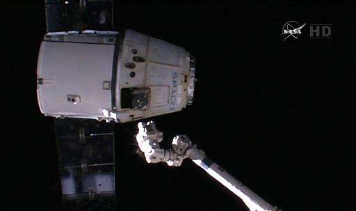 This image from NASA TV shows the SpaceX Dragon undocking from the International Space Station on February 10, 2015