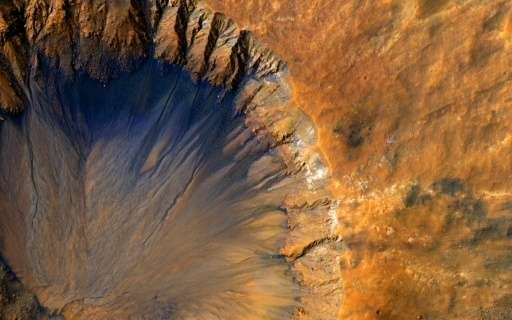 "This NASA/JPL/University of Arizona image obtained June 7, 2015 shows a close-up of a ""fresh"" impact crater in the Sir"