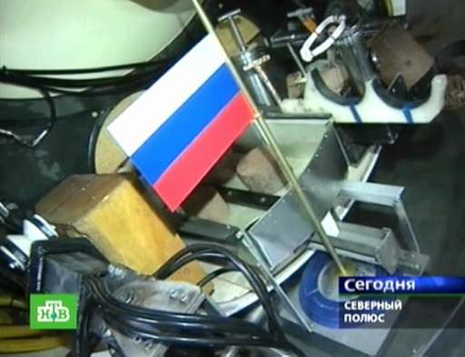 This Russian NTV channel image grab taken on November 7, 2014 shows the Russian flag fixed on board the Mir-1mini-submarine as i