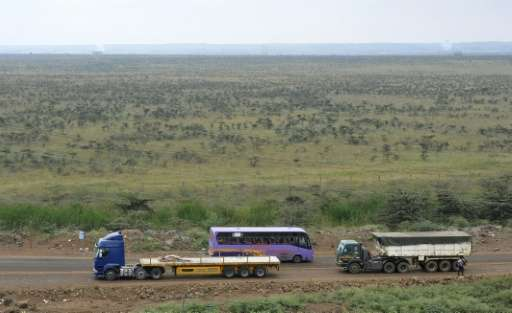 Trucks and buses drive past on August 4, 2015 the area in Nairobi where Kenya's new Chinese-built rail line will cut through the