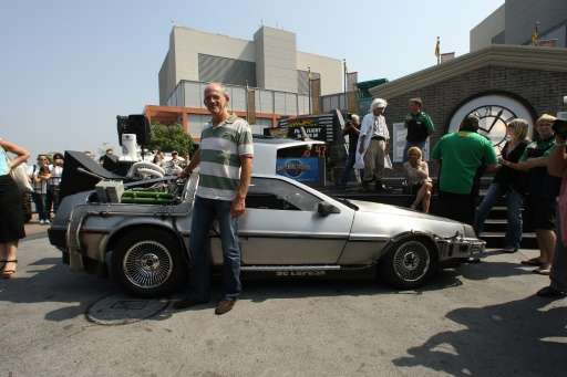"US actor Christopher Lloyd, who plays ""Doc"" Brown in the movie ""Back to the Future II,"" poses with the DeLor"